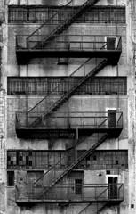 Back door [Explored] (_Franck Michel_) Tags: urban blackandwhite bw stairs canon eos industrial factory noiretblanc steel explorer demolition nb creepy explore usine escaliers industriel acier rouillé explored 400d canon400d