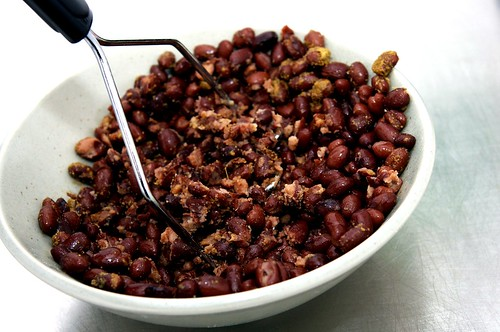 smashing black beans