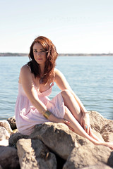 (The Vision Beautiful) Tags: red sea portrait lake water girl beautiful hair gold rocks gorgeous redhead shore bracelet smirk rockwall pinkdress katyeskillman