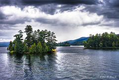 On An Island... (darth_bayne) Tags: newyork mountains water island 50mm lakegeorge hdr darkclouds boatride canon350 supershot vosplusbellesphotos darthbayne