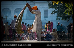 --A moment in a day at the Golden Temple-- (Raminder Pal Singh) Tags: lighting people india water backlight work canon droplets wash turban punjab washing amritsar goldentemple canon1d harimandirsahib darbarsahib harimandarsahib shotoncanon asewadaratthegoldentemple lifeatgoldentemple