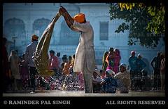 --A moment in a day at the Golden Temple-- (Raminder Pal Singh) Tags: lighting people india water backlight work canon droplets wash turban punjab washing amritsar goldentemple canon1d harimandirsahib darbarsahib harimandarsahib shotoncanon asewadaratthegoldentemple lifeatgoldentemple