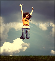 Jump For Joy (Poe Tatum) Tags: sky woman motion girl grass shirt female happy jump jumping lomo reaching action joy jeans 70s process midriff digitalcameraclub