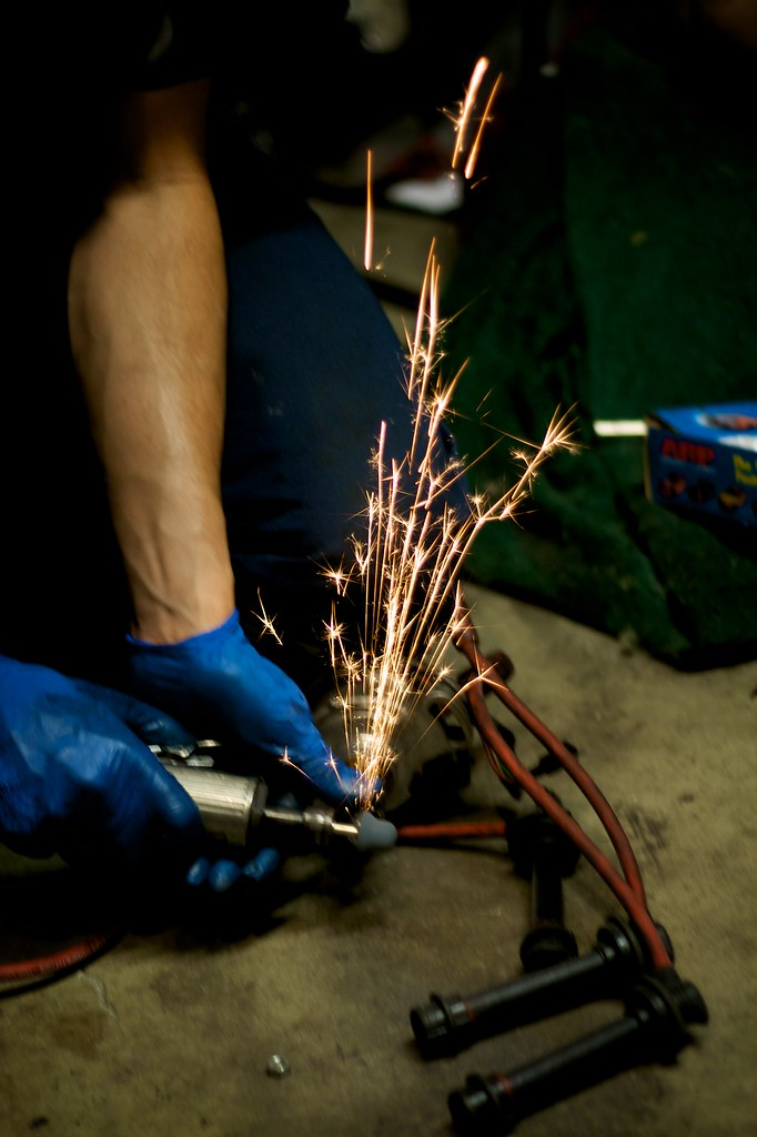 Sparks from griding down a part to fit in a Corolla
