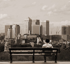 away from the noise (ssj_george) Tags: leica city uk trees england people music man london skyline sepia buildings bench bristol relax landscape lumix back europe alone view away panasonic single wharf sit headphones behind canary noise greenwhich aplusphoto tz3 platinumheartaward