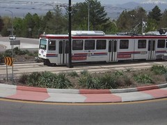 TRAX passing east through roundabout (2nd view)