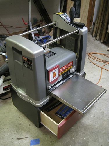 rolling base drawer open under deployed planer