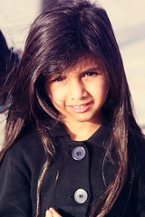 (FatoOoma Qatar ~) Tags: camera portrait baby black cute eye love girl beautiful beauty smile face smiling canon hair happy person photo kid eyes flickr pretty day child image time little young longhair picture adorable lips human smiley eyebrow 2009 fatma doha qatar smiler beautifully smiled flickcom famel shahad 400d  fatoooma