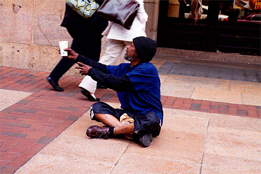 Man-on-ground-begging--Center-City