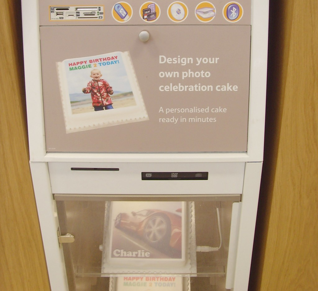 Pop in your memory card and design your own photo cake....