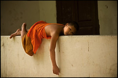 lazy time (fly) Tags: temple asia monk lao luangprabang fly simonkolton