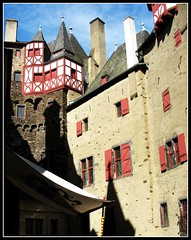 Central Inner Courtyard - Burg Eltz, Germany (Batikart ... handicapped ... sorry for no comments) Tags: travel summer vacation castle window architecture canon germany geotagged deutschland interestingness holidays europa europe sommer urlaub burgeltz innenhof sightseeing scenic f100 medieval eifel historic explore architektur 2009 vacanze halftimbered burg koblenz trier 2007 mosel canonpowershot rheinlandpfalz a610 moselle fachwerk elz eltz innercourtyard mnstermaifeld canonpowershota610 wierschem rhinelandpalatinate 100faves i500 fairytalecastle mywinners viewonblack batikart sehenwrdigkeit elzriver