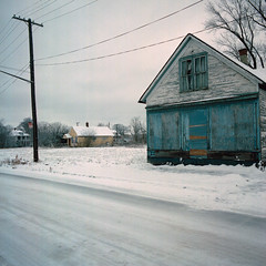 (Kevin Bauman) Tags: city houses homes urban white house snow abandoned film home facade peeling paint downtown exterior decay michigan small detroit snowstorm hasselblad abandonedhouse isolation peelingpaint abandonment isolated decaying pealingpaint abandonedhouses