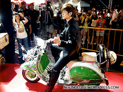 Show Luo enters on a Vespa