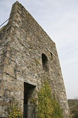 Exterior with ivy. (john durrant) Tags: uk chimney brick cornwall ivy arches stack granite coppermine tinmine redruth kernow quoins whealamelia pennanceconsols carnmarth baronetsenginehouse