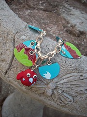 Red Birdie Upcycled charm bracelet (Jupita) Tags: blue birds recycled jewelry starbucks bracelet eco charms giftcard beading beaded charmbracelet repurposed polyclay upcycled starbuckscard trashion polymerclaybead jupita simplyplushed
