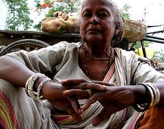(mayukh_phys) Tags: portrait woman india face hands market expression ring kolkata seller bazar