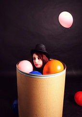 Day 238 - Letters to Cleo (miriness) Tags: portrait silly girl blackbackground balloons fun funny sad tophat colourful studioportrait clownmakeup sittinginabox behavinglikeakid