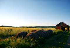 Alarm Clock (theysayjump) Tags: blue trees red sky field grass barn farm wheat country hay bales