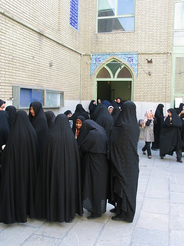 Veiled Iranian women line up for voting