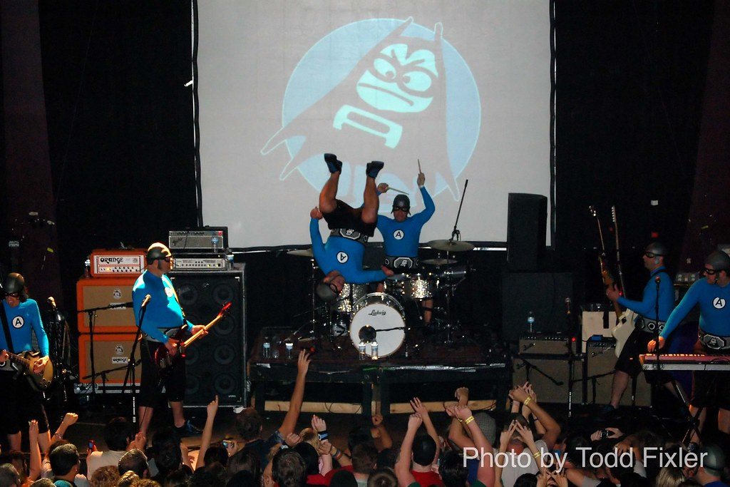 "the Aquabats - Ian Fowles aka Eagle ""Bones"" Falconhawk, Chad Larson aka Crash McLarson, Christian Jacobs aka MC Bat Commander, Ricky Falomir aka Ricky Fitness and James Randall Briggs aka Jimmy the Ro"