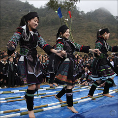 Hmong dancing over clapping Bamboo (NaPix -- (Time out)) Tags: new portrait festival buffalo women dancing year games bamboo ox vietnam celebration explore lunar journalism sapa hmong explored explorefrontpage infinestyle napix theyearofthebufalloox jawnshanochagoodheartnewyearinhmong hmongdancingoverclappingbamboo cccunanimous