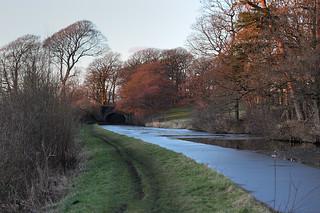 Lancaster Canal frozen at Double Bridge, near Galgate, Lancashire, UK