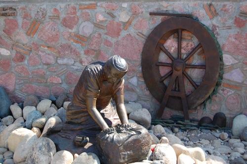 Sculpture of man working in Puerto Vallarta Mexico
