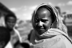 school girl portrait (LindsayStark) Tags: africa travel school portrait blackandwhite girl children war child refugee muslim islam hijab conflict somali ethiopia schoolkids humanrights humanitarian somalia displaced refugeecamp humanitarianaid emergencyrelief postconflict waraffected conflictaffected jijiga