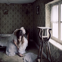 the girl has come undone (moggierocket) Tags: old light wallpaper abandoned window girl bed bedroom belgium room atmosphere dirt forgotten d200 weddingdress melancholy dickens deserted abandonment 500x500 goldcollection mrshaversham winner500 hourofthesoul