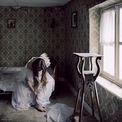 the girl has come undone (moggierocket) Tags: old light wallpaper abandoned window girl bed bedroom belgium room atmosphere dirt forgotten d200 weddingdress melancholy dickens deserted abandonment 500x500 goldcollection mrshaversham winner500 hourofthesoul