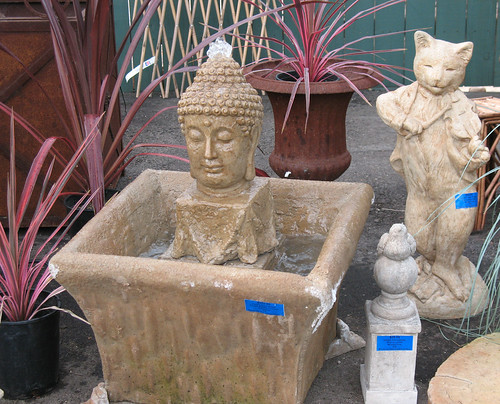 budhha fountain, cat fiddler statue