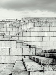 Escheresque (loungerie) Tags: bw italy building brick art monument lines architecture stairs geometry perspective bn confused marble escher copertina friuli escheresque scalinata marmo redipuglia sacrario winnerflickrsweeklythemecontest