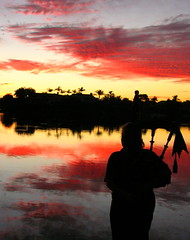 Lakeside Piper (blue foot) Tags: pink sunset water clouds reflections palms silhouettes australia queensland colourful piper bagpipes the4elements anawesomeshot ilovemypics