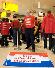 Anti-aviation campaigners put new words to old Eurovision favourites as they join together at Heathrow Terminal One to protest against the 3rd runway and aviation expansion. by Euroflashmob Heathrow and Europe