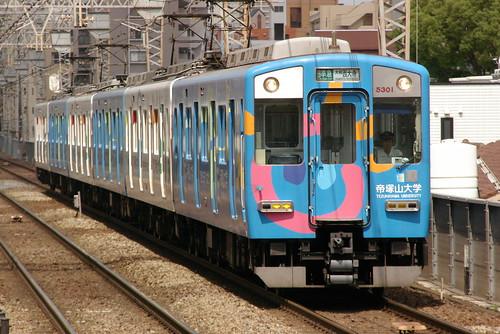 Kintetsu5800series(Tezukayama univ.ad color) in Imazato,Osaka,Osaka,Japan 2009/5/29