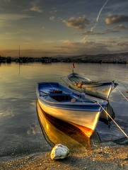 Yesterday ... (Nejdet Duzen) Tags: trip travel sea fab reflection clouds turkey boat trkiye fisher shelter yesterday deniz sandal izmir bulut yansma turkei seyahat flickrsbest barnak abigfave inciralt bal colorphotoaward dn vosplusbellesphotos saariysqualitypictures