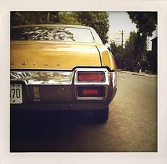 cutlass (Grey van der Meer) Tags: cameraphone street toronto polaroid retro depthoffield parked camerabag taillights musclecar iphone 1971oldsmobilecutlass shakeitphoto tiltshiftgen psmobile