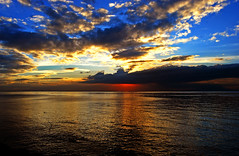 Sea of Faces (maraculio) Tags: sunset sea sky art colors wow photography faces philippines moa manilabay kutless mallofasia