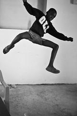 leaping boy (LOVE_LensOfVision&Expression) Tags: children haiti orphanage international developingcountry plantingpeace claudy portauprince globalpoverty photographyworkshop thirdworldcountry marginalizedchildren nonforprofitorganization lovelensofvisionexpression projectpapillon