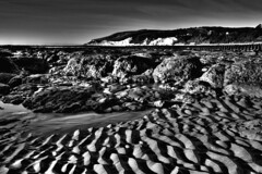 Ripples (Phil-Clements) Tags: sea blackandwhite white black texture beach contrast canon sussex sand rocks tide eastbourne rockpools holywell 450d