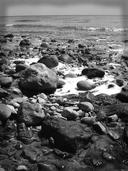 Seashore Rocks (PureWarriorMaiden - More off than at the mo : )) Tags: ocean sea blackandwhite bw beach nature monochrome seaside rocks waves tide pebbles seashore greyscale charmouth