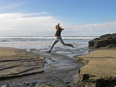 The Leap (mswee10) Tags: ocean woman beach water oregon person coast florence jump sand stream thecoast thechallengegame challengegamewinner contestcoast