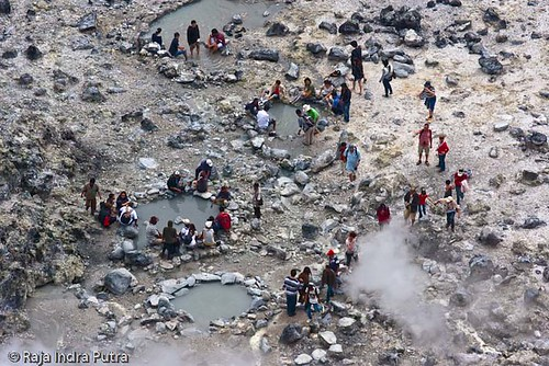 People gather around the hot springs