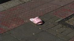 Cinderella (monkeymillions) Tags: pink abandoned lost pavement cinderella slipper