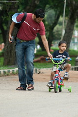 Love you Dad... | Lalbagh Park | Bangalore (s h a i l e n d r a.... back.. :)) Tags: man love bicycle loving canon dad child sweet father bangalore innocent son beta papa caring lalbagh ef100300 400d canon400d fatherwithson shailendrasinghchouhan teachinghowtoridebicycle shailendraphotography