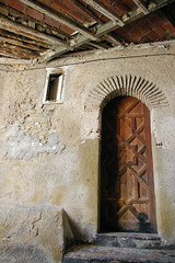 Moroccan Wooden Doorway (cwgoodroe) Tags: ocean africa street old city sea summer people sun fish bus colors metal ferry plane children cafe sand ancient colorful doors artistic pentax vibrant muslim poor streetlife mosque arabic panasonic doorway morocco arab friendly moors conservative script casbah vegtable merchants continent merchant christians tangier monger moroccan tanger kasbah cleric sadfaces metaldoors fishmerchant casba casbha dailylifeportrait