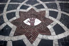 Tarquinia. (womansea) Tags: strada mano piazza occhio disegno tarquinia geometria pavimento simboli womansea