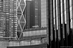 Columbus Circle Boogie Woogie (CVerwaal) Tags: blackandwhite architecture analog patterns olympus ishootfilm oldschool xp2 columbuscircle ilford zuiko olympusom1 timewarnercenter hearstbuilding zuiko100mmf28