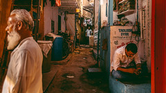 Mumbai Slums (mungkey) Tags: street portrait people urban india streets colors face colorful photographer faces candid grain streetphotography human noise mumbai incredible slum humans slums 16x9 colorgrading